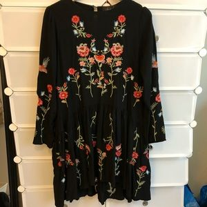 Black dress with floral embroidery by Chicwish